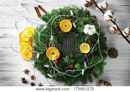 Beautiful Christmas wreath on table