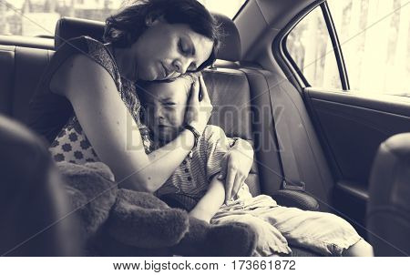 Mother Soothes Her Son Crying in the Car