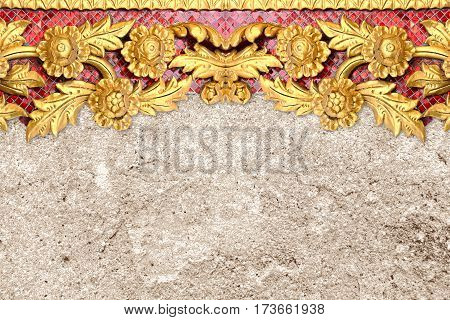 pattern of gold flower carved on cement wall background.