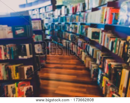 Vintage style color tone. Blur image of a bookstore.