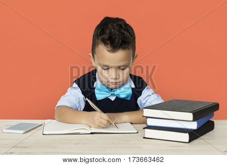 A Caucasian Boy Studying Writing Background Studio Portrait