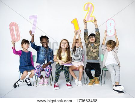 Children Holding Figures Studio Concept