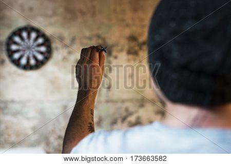 Man Play Dartboard Arrows Game Activity