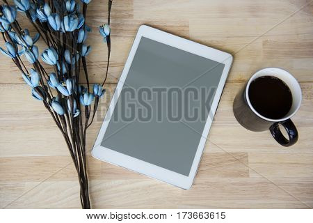 Digital Tablet Coffee Cup Flower Wooden Table Copy Space