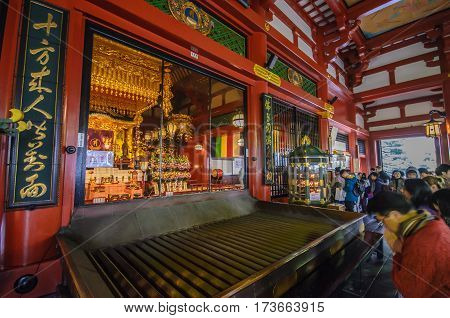 Tokyo Japan - November 19 2016 : Inside the main hall of Senso-ji Temple in Asakusa Tokyo Japan . The Senso-ji Temple in Asakusa is the most famous temple in Tokyo .