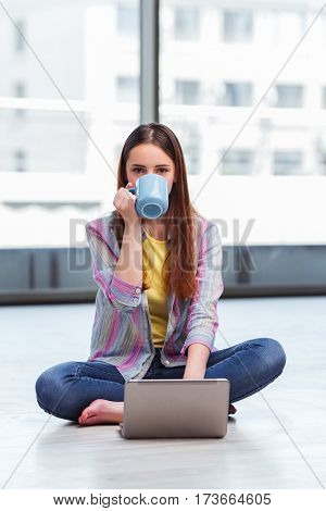 Young girl surfing internet on laptop