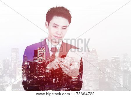 Double Exposure Of Businessman Using The Tablet Against City Isolated On White Background