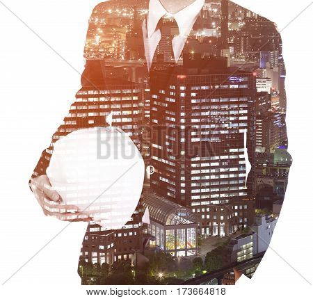Double exposure of engineer with helmet against a city isolated on white background