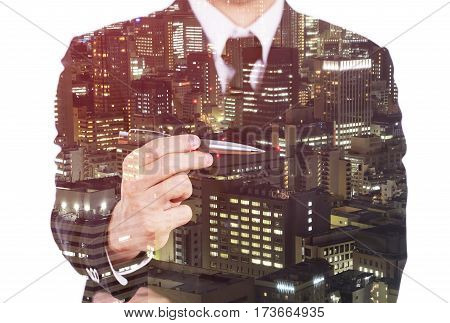Double Exposure Of Business Man Holding A Pen Against City Isolated On White Background