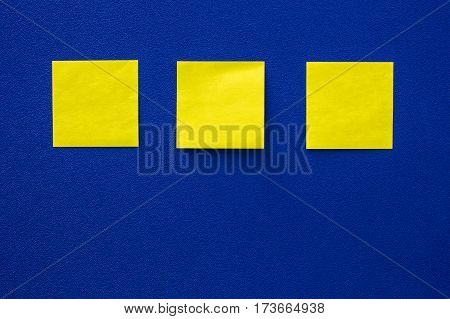 The yellow note paper on blue background