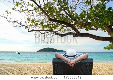Young attractive woman relaxing on the beautiful beach