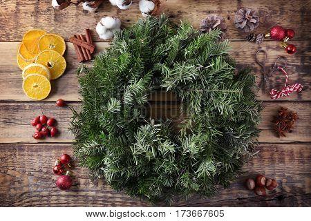 Beautiful Christmas wreath on table