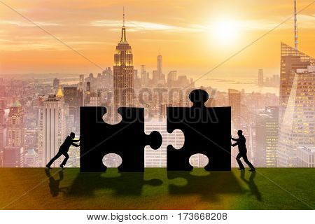 Business metaphor of teamwork with jigsaw puzzle