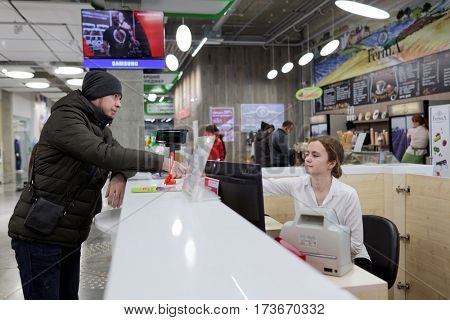 ST. PETERSBURG, RUSSIA - OCTOBER 27, 2016: Client pays his order in the fulfillment center of Ulmart company. Ulmart is one of the largest Internet retailers in Russia