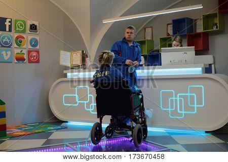ST. PETERSBURG, RUSSIA - FEBRUARY 16, 2017: Patient in a wheel chair in the reception of St. Magdalena children's hospital. The hospital was founded in 1829