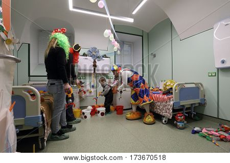 ST. PETERSBURG, RUSSIA - FEBRUARY 16, 2017: Doctor in clown costume examines the child in the St. Magdalena children's hospital. The hospital was founded in 1829