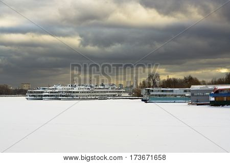 Boats on the quay of the river port city of Moscow in the winter