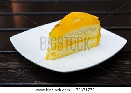 orange cake with orange fruit on topping in dish