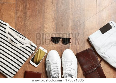 Flat lay set of male clothes and accessories on wooden background