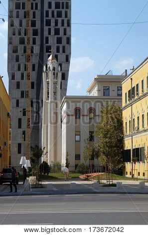 TIRANA, ALBANIA - SEPTEMBER 27: Orthodox Cathedral is overshadowed by new high-rise construction, Tirana, Albania on September 27, 2016.
