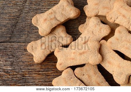 A top view image of several bone shaped dog treats.