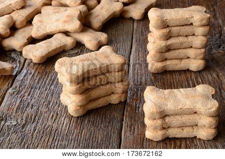 A top view image of several bone shaped dog treats.
