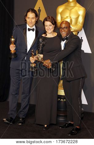 Adele Romanski, Barry Jenkins and Jeremy Kleiner at the 89th Annual Academy Awards - Press Room held at the Hollywood and Highland Center in Hollywood, USA on February 26, 2017.