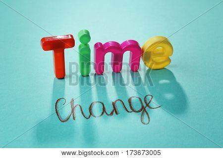 Motivation concept. Phrase TIME CHANGE on blue background