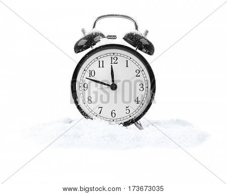Alarm clock with snow isolated on white