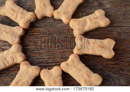 A top view image of dog treats in a semi-circle.