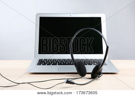 Laptop with headset on white table