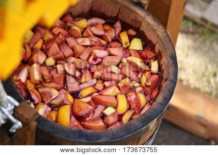 Homemade compote in wooden bucket