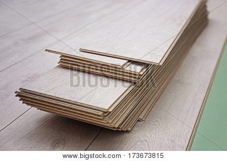 Wooden panels on new laminated flooring