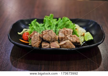 Beef grilled steak and vagetable fresh served on wooden table