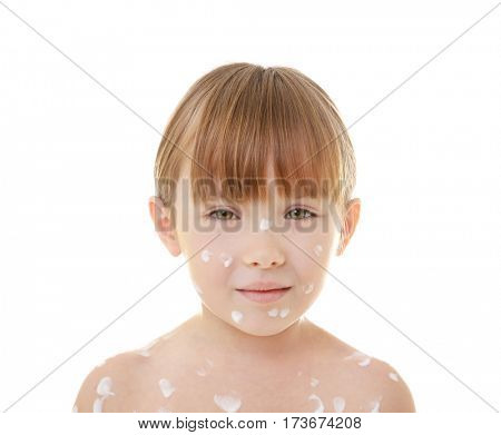 Portrait of little girl with chickenpox on white background