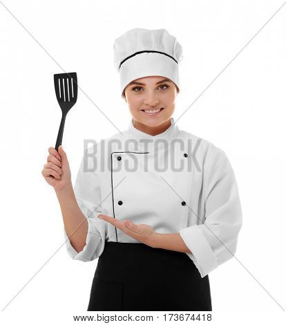 Portrait of young woman chef with spatula isolated on white background