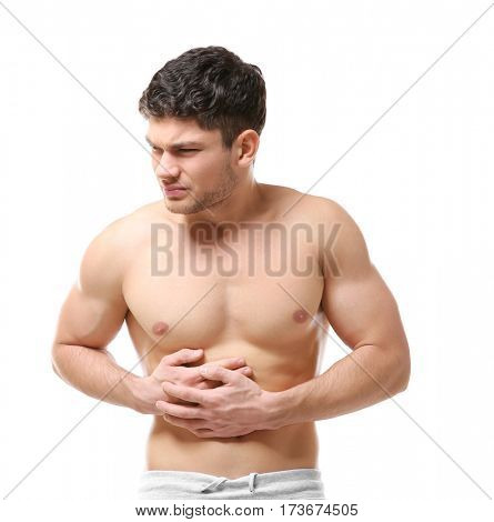 Handsome young man suffering from abdominal pain on white background