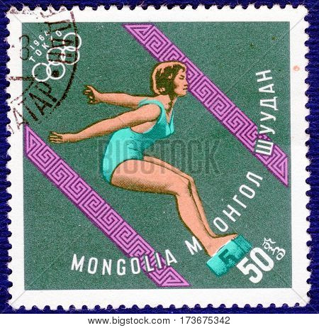 MONGOLIA - CIRCA 1964: Postage stamp printed in Mongolia with a picture of a swimming, with the inscription