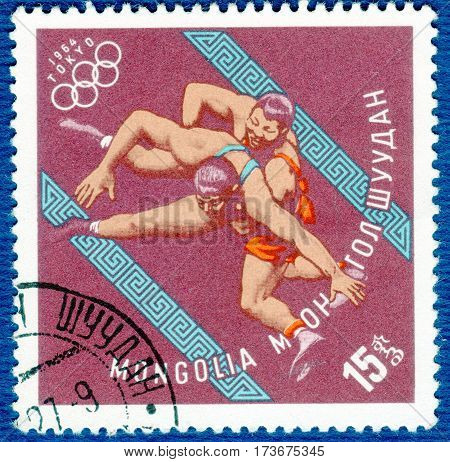 MONGOLIA - CIRCA 1964: Postage stamp printed in Mongolia with a picture of a wrestling, with the inscription