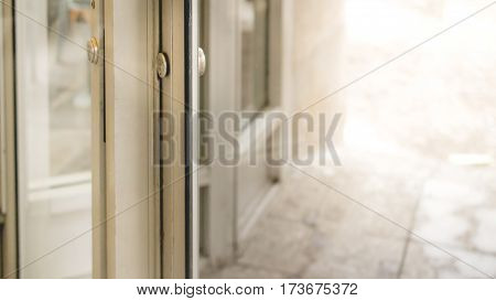 Locking up or unlocking door of restaurant with morning light for ad or website promote