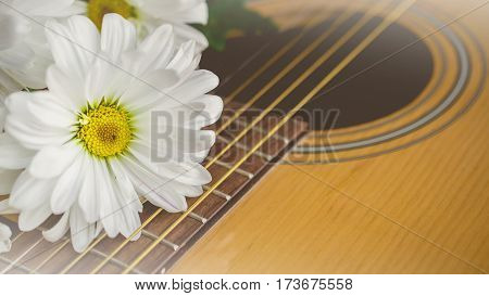 Morning relaxation and cozy with white daisy on guitar for Rural vacation lifestyle music therapy concept