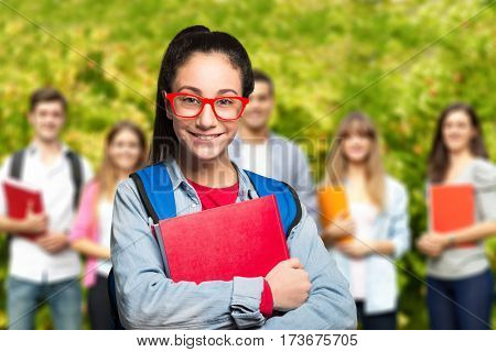 Smiling student in front of a group of classmates