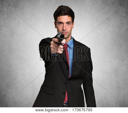 Man pointing his gun