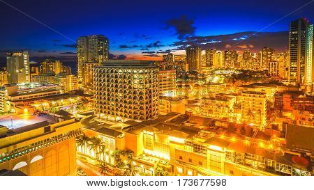 Aerial view night life of Waikiki skyline in Oahu island Hawaii, United States. City night lights and nightlife concept.