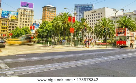 San Francisco, California, United States - August 17, 2016: Double-decker bus in Union Square downtown San Francisco. Popular for shop fashion clothing and accessories. Urban cityscape.