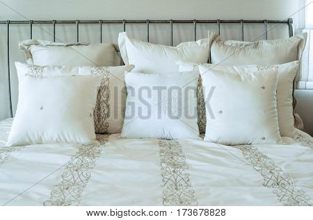 bedroom with classic bed and pillows at home