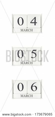 Closeup group of white wooden calendar with black 4 5 6 march word three date calendar isolated on white background
