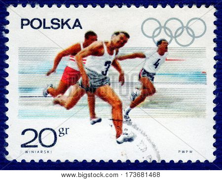 POLAND - CIRCA 1967: Postage stamp printed in Poland with a picture of aathletes runners, from the series
