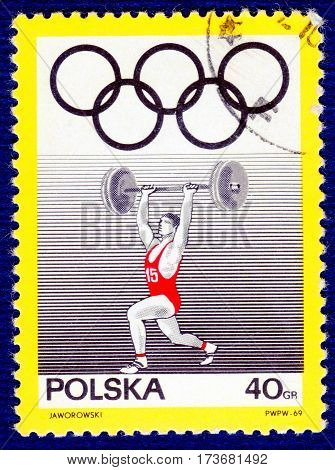 POLAND - CIRCA 1969: Postage stamp printed in Poland with a picture of a weightlifting, from the series