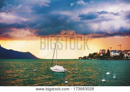 Storm over lake Geneva (Lac Leman) at sunset, Montreux, Canton of Vaud; Switzerland